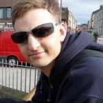 Photo of James wearing sunglasses