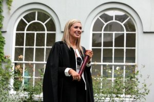 Sinead wearing a black gown and holding a sroll