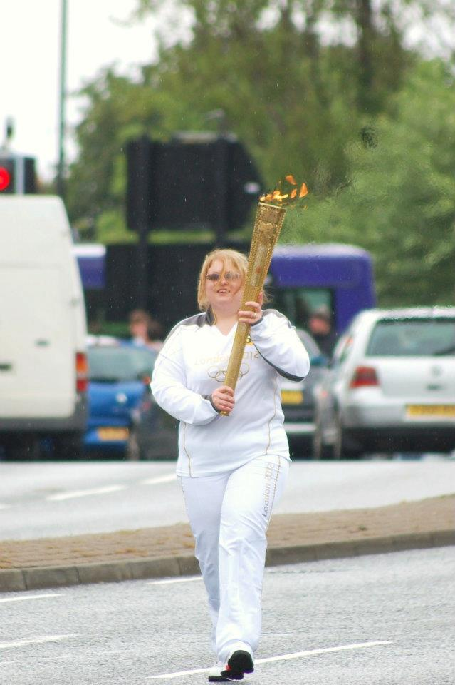 Claire carrying the Olympic Torch