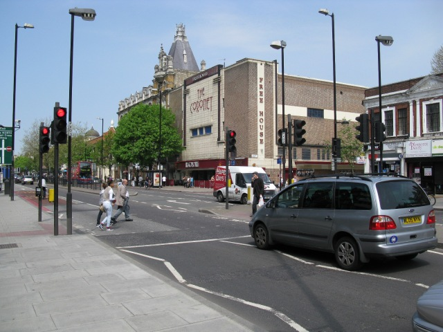 Pedestrian crossing with former cinema in the background