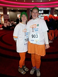 Sisters wearing their carrot themed costumes