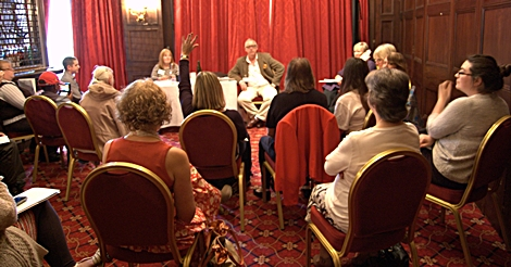 A panel of speaker with an audience asking questions