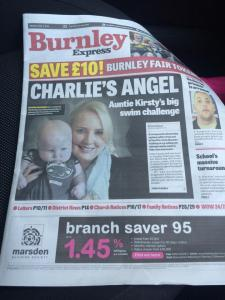 Front page of the Burnley Epxress with headline: Charlie's Angel and picture of him and his mum