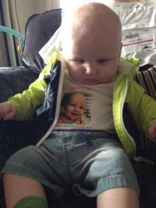 Charlie wearing a t-shirt with a picture of his face on it