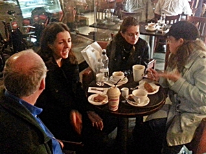 People with aniridia and parents sitting around a table in a coffee shop