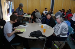 Delegates sitting talking around a circular table