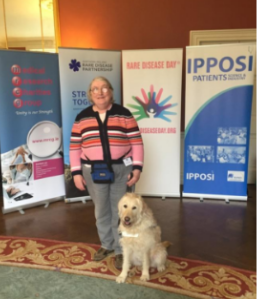 In the background giant posters for IPPOS, Rare Disease Day, STRONGER TOGETHER, Medical Research Charities Group - Unity is our strength
