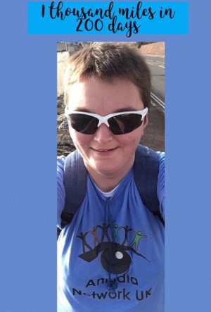 1 thousand miles in 200 days. Laura walking while wearing a Aniridia Network tshirt