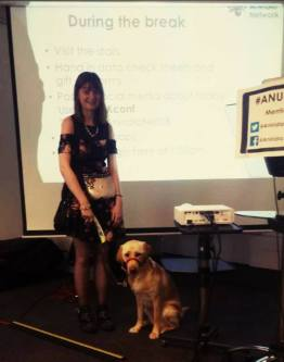 Fern Lulham and her guide dog Nancy in front of the projection screen