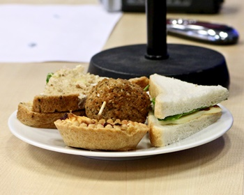 Plate of food including a tart, and two sandwiches