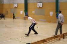 James practising bowling a goalball