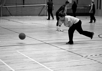Katie practicing bowling a goalball