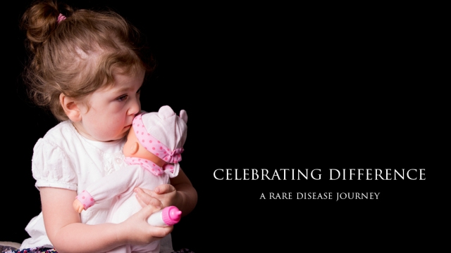 Toddler with doll. Celebrating Difference. A rare disease journey
