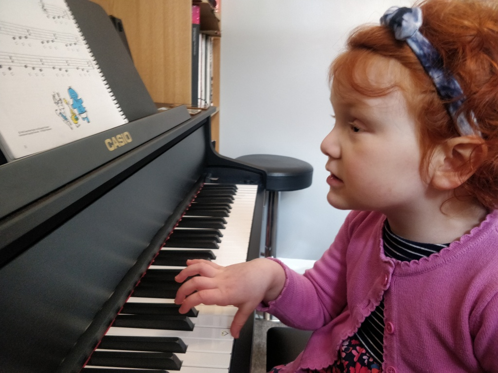 4 year old girl playing piano